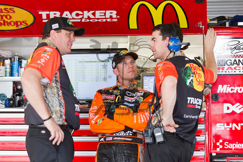 Daytona Beach, FL - Feb 18, 2012:  Jamie McMurray (1) talks to his crew before a practice session for the Daytona 500 at the Daytona International Speedway in Daytona Beach, FL.