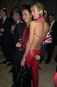 David Morris ( behind) Andy Wong and Lady Victoria Hervey. David Morris 'Glitter and Glamour party. The Sanderson Hotel, London. 12 December 2000 © Copyright Photograph by Dafydd Jones 66 Stockwell Park Rd. London SW9 0DA Tel 020 7733 0108 www.dafjones.com