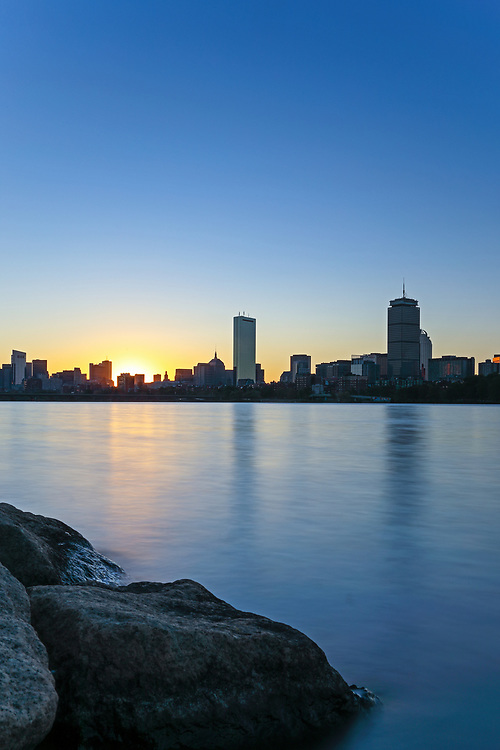 Boston sunrise photograph featuring familiar landmarks along the Charles River, such as the Prudential Center and 200 Clarendon better known as the John Hancock Tower. This Boston skyline photo at the early morning light is available as museum quality photography prints, canvas prints, acrylic prints or metal prints. Fine art prints may be framed and matted to the individual liking and decorating needs:<br />  <br /> https://juergen-roth.pixels.com/featured/boston-at-sunrise-juergen-roth.html<br /> <br /> All Sunrise Boston photos are available for digital and print photography image licensing at www.RothGalleries.com. Please contact me direct with any questions or request.<br /> <br /> Good light and happy photo making!<br /> <br /> My best,<br /> <br /> Juergen<br /> Prints: http://www.rothgalleries.com<br /> Photo Blog: http://whereintheworldisjuergen.blogspot.com<br /> Instagram: https://www.instagram.com/rothgalleries<br /> Twitter: https://twitter.com/naturefineart<br /> Facebook: https://www.facebook.com/naturefineart