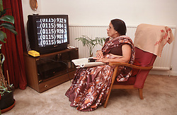 Woman with visual impairment using text magnifier,