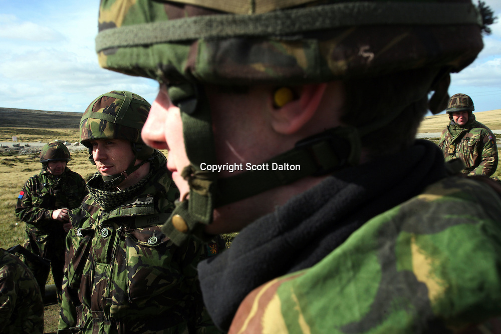 British soldiers look on during artillery training at the Mount Pleasant Complex, a joint army and air force base in the Falkland Islands on Thursday, March 22, 2007. After the 1982 invasion of the islands by Argentinean forces, the United Kingdom has a strong military presence to protect the island from any possible future aggressions. (Photo/Scott Dalton)