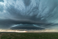 With severe weather in the forecast, I headed downstate to do some storm chasing. This cell formed over the Laramie Mountains before pushing east onto the High Plains. At first it took it's time maturing. But just before 4PM it transformed from an ok looking storm into this in only 10 minutes. As the storm moved into a better wind shear environment, it turned into a mothership supercell displaying very impressive structure. I was mesmerized watching it roll across the Nebraska stateline outside of La Grange. Despite the ominous and otherworldly look, the storm wasn't severe at this time. As it passed over me it brought small hail and blowing dust with lots of tumbleweeds.