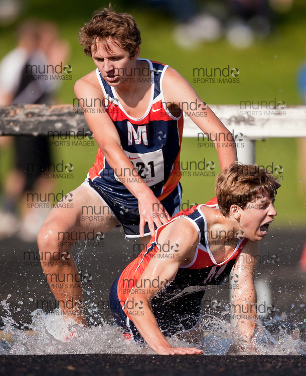 Kitchener, Ontario ---29/05/09--- J. Swainson, left of Massey pushes off teammate S. Pitman during the 2000m Steeplechase at the 2009 OFSAA West Regionals track and field meet at Resurrection in Kitchener, Ontario, May 29, 2009..GEOFF ROBINS Mundo Sport Images
