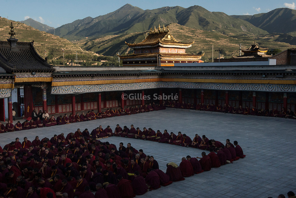 For a story by Andrew Jacobs-Dan Levin<br /> Nomad resettlement - Resurgence of Dalai Lama images<br /> Tongren, August 11 2013<br /> In a courtyard of Rebkong monastery, monks have gathered for a philosophy class.<br /> Gilles Sabrie for The New York Times