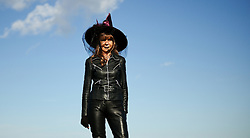 © Licensed to London News Pictures. <br /> 01/11/2014. <br /> <br /> Whitby, Yorkshire, United Kingdom<br /> <br /> Doreen Devos from Newark comes dressed as a witch to the 20th anniversary of the Whitby Goth Weekend. <br /> <br /> The event this weekend brings together thousands of extravagantly dressed followers of Victoriana, Steampunk, Cybergoth and Romanticism who all visit the town to take part in celebrating Gothic culture. This weekend marks the 20th anniversary since the event was started by local woman Jo Hampshire.<br /> <br /> Photo credit : Ian Forsyth/LNP