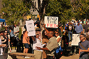 "About 1,000 demonstrators participated in Occupy Tucson at Military Plaza in Armory Park, Tucson, Arizona, USA.  The Occupy Tucson organizers created the movement in solidarity with the Occupy Wall Street movement in New York and the Occupy Together movement across the USA.  A counter protestor (brown shirt), who declined to be identified, shouts, ""Stop protesting and get a fuckin job."" ..The leaders of this movement are the everyday people participating in a movement with many de-centralized goals, with an over-arching theme of protesting government corruption from corporate money and national income disparity. We use a tool called the ""General Assembly"" to facilitate open, participatory and horizontal organizing between members of the public. We welcome people from all colors, genders and beliefs to participate in our movement. .."