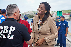 Congresswoman Stacey Plaskett shakes hands with a member of the Coastal Border Patrol.  Coast Guard Boat Forces in the US Virgin Islands unveil two of the four 33-Special Purpose Craft Law-Enforcement (SPC-LEs) Boats that will be stationed in St. Thomas.   The SPC-LE's are specially built for counter-drug and migrant missions while patroling the border.  © Aisha-Zakiya Boyd