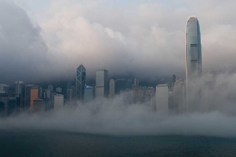 Early morning fog in Victoria Harbor, Hong Kong.