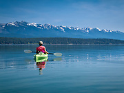 Kayaking on Flathead Lake with Linda Graf / Woman kayaking on Flathead Lake looking at the Mission Mountains in NW Montana.