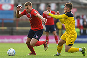 Simon Heslop of York City (8) tries to attack forward with the ball as Declan Weeks of Kidderminster Harriers (7) looks to hold him back during the Vanarama National League match between York City and Kidderminster Harriers at Bootham Crescent, York, England on 15 September 2018.
