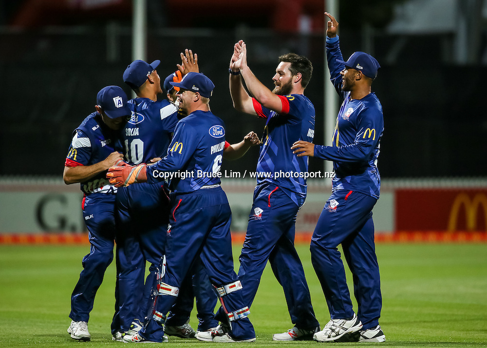 The Auckland Aces celebrate a wicket during the McDonalds Super Smash T20 cricket match - Knights v Aces played at Seddon Park, Hamilton, New Zealand on Saturday 17 December.<br /> <br /> Copyright photo: Bruce Lim / www.photosport.nz