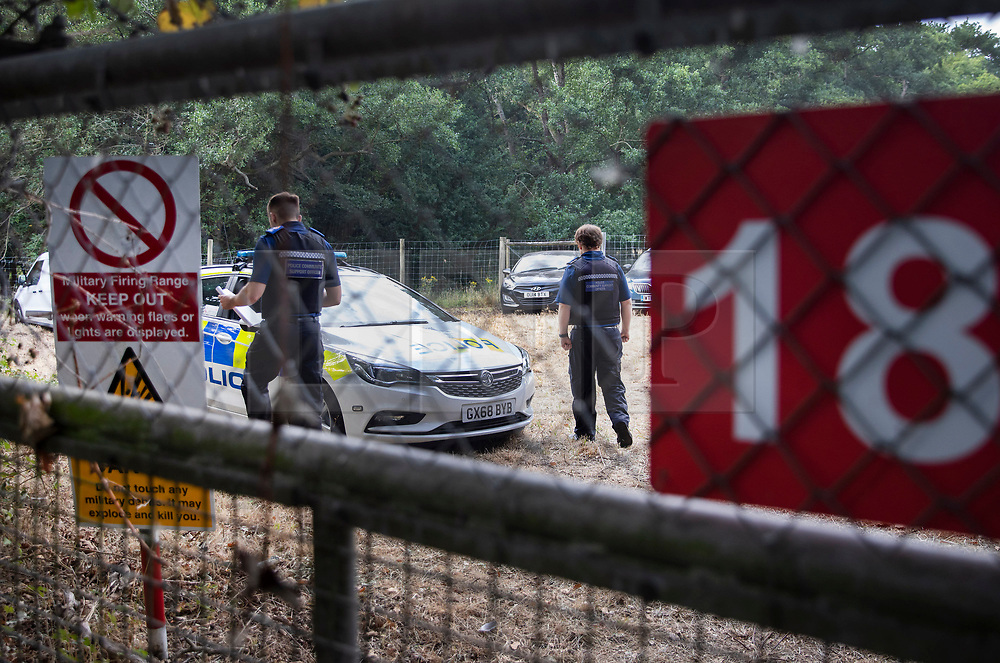 © Licensed to London News Pictures. 11/08/2020. Bisley, UK. Police investigate an area near Bisley in Surrey as part of an historic murder inestigation. Surrey Police, supported by the British Army and specialist forensic teams are carrying out a dig at an area of land near in Bisley in relation to the murder of Tina Baker, 41, in 2002. <br /> Tina was initially reported missing after last being seen in Sunbury on 8 July 2002 but the investigation became a murder enquiry in October 2002. In 2005, following an extensive investigation by the Surrey and Sussex Major Crime Team, Tina's husband, Martin Gerald Baker, was arrested and charged with her murder. In 2006, he was sentenced to 14 years behind bars. Tina's body was never recovered. Following the conviction, enquiries continued by Surrey Police in order to find out what happened to Tina Baker's body. Information received has resulted in the decision to carry out forensic investigations in Bisley. Photo credit: Peter Macdiarmid/LNP