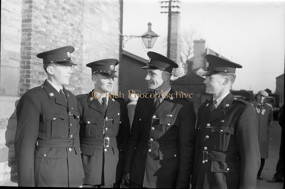 20/12/1963<br /> 12/23/1963<br /> 20 December 1963<br /> Last passing out parade of Gardai at the Garda Depot Phoenix Park, Dublin. Cork recruits (L-R): T.P. Dillon (Bantry), P.Twomey (Charleville), D.F. Walsh (Ballinhassig) and J. Lawton (Ballymacoda), chatting after the parade.