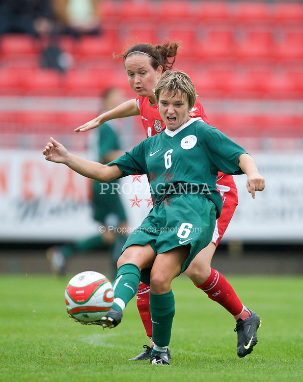 LLANELLI, WALES - Sunday, August 23, 2009: Wales' captain Cheryl Foster in action against Slovenia's Polona Govek during a friendly international match at Stebonheath Park. (Pic by David Rawcliffe/Propaganda)
