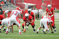 01 September 2012:  Center Pete Cary, Quarterback Matt Brown and Running back Darrelynn Dunn during an NCAA football game between the Dayton Flyers and the Illinois State Redbirds at Hancock Stadium in Normal IL