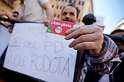 2013/04/18 Roma, proteste in piazza Montecitorio contro la mancata candidatura di Stefano Rodota' a presidente della Repubblica. Nella foto un iscritto del PD.<br /> Rome, protests and demo in Piazza Montecitorio against the non-candidacy of Stefano Rodota ' for president . In the picture a PD militant hold is card; the note reading ' PD people want Rodota' ' - &copy; PIERPAOLO SCAVUZZO