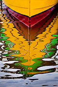 Colorful tour boats reflected in the water on Ilha do Mel, Brazil, South America