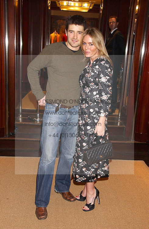 Actor TOM CHAMBERS and actress PATSY KENSIT at a party at Ralph Lauren, Bond Street, London in support of the NSPCC's Full Stop campaign on 21st March 2006.<br />