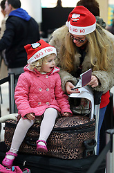 Janine Adamson and her daughter Maizie (2) from Southampton check their passports  at London Gatwick airport as the Christmas getaway starts Friday, 20th December 2013. Picture by Stephen Lock / i-Images
