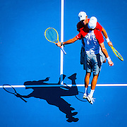 The American Bryan brothers celebrate their Men's Doubles win in the 2013 Australian Open. The Open is a Grand Slam Tournament - is the opening event of the tennis calendar annually. The Open is held each January in Melbourne, Australia.