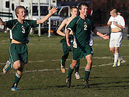 Middletown, New York  - Hamilton High School soccer players celebrate their victory over Chazy in the New York State Class D boys' soccer championship game on Nov. 20, 2011.