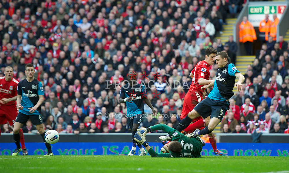LIVERPOOL, ENGLAND - Saturday, March 3, 2012: Liverpool's Martin Kelly sees his shot saved by Arsenal's goalkeeper Wojciech Szczesny during the Premiership match at Anfield. (Pic by David Rawcliffe/Propaganda)