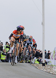 Lizzie Armitstead looks back to see the damage she's caused on the first time up the VAMberg.