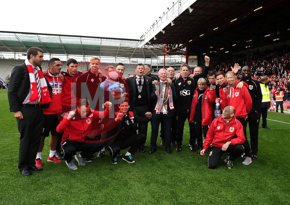 Bristol City's majority shareholder, Steve Lansdown, Bristol City manager, Steve Cotterill and Bristol City back room staff celebrate with the League One Trophy  - Photo mandatory by-line: Joe Meredith/JMP - Mobile: 07966 386802 - 03/05/2015 - SPORT - Football - Bristol - Ashton Gate - Bristol City v Walsall - Sky Bet League One