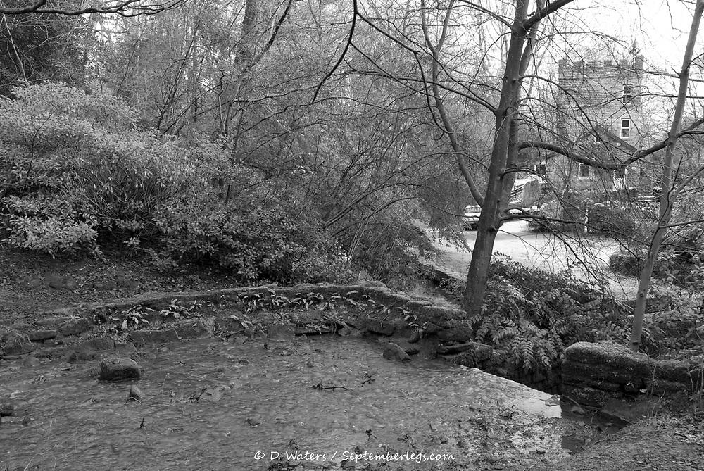 Sheffield, UK - Jan 2015: Cascade in Tinker Brook before Glen Howe Tower on 18 Jan 2015 at Glen Howe Park, Wharncliffe Side