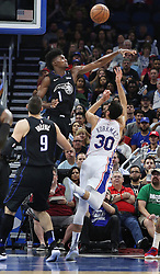 November 14, 2018 - Orlando, FL, USA - The Orlando Magic's Jonathan Isaac (1) blocks the shot of the Philadelphia 76ers' Furkan Korkmaz (30) at the Amway Center in Orlando, Fla., on Wednesday, Nov. 14, 2018. (Credit Image: © Stephen M. Dowell/Orlando Sentinel/TNS via ZUMA Wire)