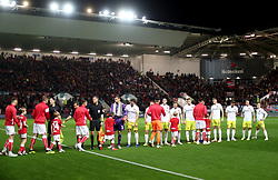 Bristol City players and Hull City players shake hands before the match begins