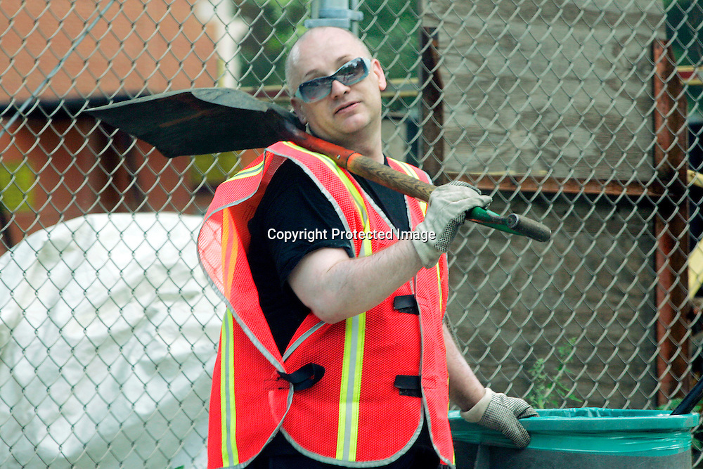 George O'Dowd, known by his performance name Boy George, works as part of five days of community service cleaning the streets of lower Manhattan after pleading guilty to one count of filing a false police report, in New York, August 15, 2006. Photo by Keith Bedford