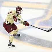 Michael Sit #18 of the Boston College Eagles with the puck during The Beanpot Championship Game at TD Garden on February 10, 2014 in Boston, Massachusetts. (Photo by Elan Kawesch)
