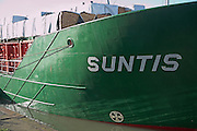 Suntis cargo ship carrying timber. Urban redevelopment of docks, Ipswich Wet Dock, Suffolk, England