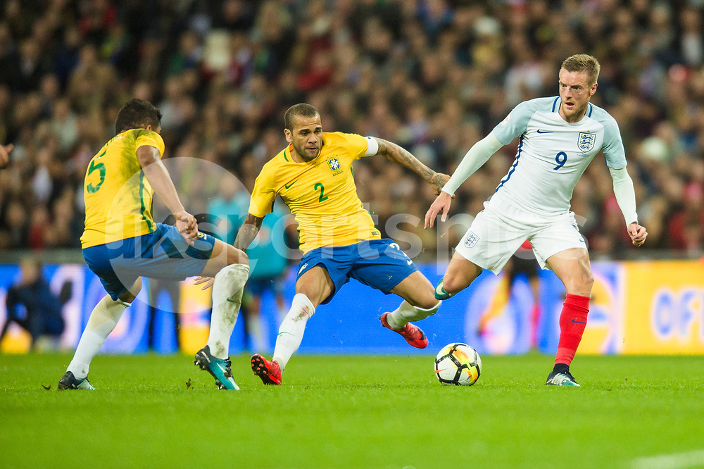 Jamie Vardy of England gets past Dani Alves of Brazil during the international friendly match between England and Brazil at Wembley Stadium, London, England on 14 November 2017. Photo by Darren Musgrove.