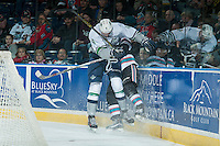 KELOWNA, CANADA - NOVEMBER 25: Turner Ottenbreit #4 of Seattle Thunderbirds checks a player of the Kelowna Rockets into the boards during first period on November 25, 2015 at Prospera Place in Kelowna, British Columbia, Canada.  (Photo by Marissa Baecker/Getty Images)  *** Local Caption *** Turner Ottenbreit;