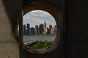 LONG ISLAND CITY, NY - JULY 18, 2016: A round window with a view of East River and Manhattan skyline at Hunters Point Community Library (currently under construction) in Long Island City. CREDIT: Emon Hassan for The New York Times