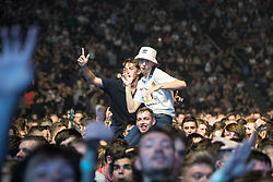 © Licensed to London News Pictures . 09/09/2017. Manchester , UK . Audience dancing . We Are Manchester reopening charity concert at the Manchester Arena with performances by Manchester artists including  Noel Gallagher , Courteeners , Blossoms and the poet Tony Walsh . The Arena has been closed since 22nd May 2017 , after Salman Abedi's terrorist attack at an Ariana Grande concert killed 22 and injured 250 . Money raised will go towards the victims of the bombing . Photo credit: Joel Goodman/LNP