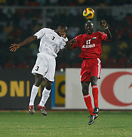 Photo: Steve Bond/Richard Lane Photography.<br />Sudan v Zambia. Africa Cup of Nations. 22/01/2008. Kennedy, Nketani (L) is beaten in the air by Faisat Agib (R)