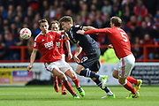 Blackburn Rovers striker Sam Gallagher (19) battles with Nottingham Forest defender Matt Mills (5) and Nottingham Forest midfielder Chris Cohen (8) during the EFL Sky Bet Championship match between Nottingham Forest and Blackburn Rovers at the City Ground, Nottingham, England on 14 April 2017. Photo by Jon Hobley.