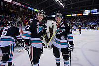 KELOWNA, CANADA - DECEMBER 5: Justin Kirkland #23 and Rodney Southam #17 of Kelowna Rockets stand on the ice with a teddy bear after the team scored the first goal against the Portland Winterhawks on December 5, 2015 at Prospera Place in Kelowna, British Columbia, Canada.  (Photo by Marissa Baecker/Shoot the Breeze)  *** Local Caption *** Rodney Southam; Justin Kirkland;