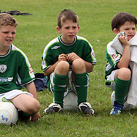 Billy Clancy, Calum Spicer and Tadghe Kennedy watching the action at the Moneypoint F.C F.A.I summer soccer camp in Kilrush during the week.<br /><br /><br /><br />Photograph by Yvonne Vaughan.