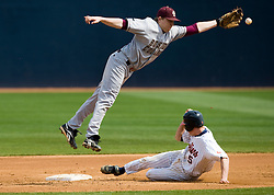Virginia Cavaliers INF Phil Gosselin (5) slides under Boston College shortstop Garrett Smith while stealing second base.  The #19 ranked Virginia Cavaliers baseball team defeated the Boston College Golden Eagles 5-4 in 10 innings at the University of Virginia's Davenport Field in Charlottesville, VA on March 22, 2008.