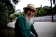 TOKYO, JAPAN, 28 SEPTEMBER - Kasumigaseki -  Demostration anti-nuclear in front of  the National Diet Bulding (Kokkai Gijidou). Toshio TERADA, 82 years old is one of the oldest demonstrator. He comes every weeks by bus from Osaka (over 450 km) to protest against the resuption of the nuclear power after Fukushima's crisis. After the demo he backs to his home town by a night bus till the following friday - September 2012
