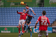 Coventry City defender Chris Stokes  beats Walsall forward Tom Bradshaw  in the air during the Sky Bet League 1 match between Coventry City and Walsall at the Ricoh Arena, Coventry, England on 12 January 2016. Photo by Simon Davies.