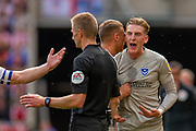 Ronan Curtis (#11) of Portsmouth FC argues with referee Michael Salisbury during the EFL Sky Bet League 1 match between Sunderland and Portsmouth at the Stadium Of Light, Sunderland, England on 17 August 2019.