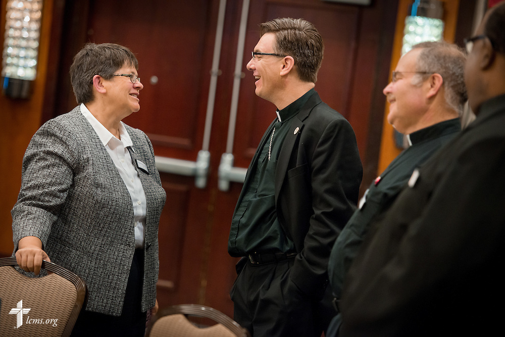 The Rev. Christopher Esget, LCMS sixth vice-president and pastor of Immanuel Evangelical-Lutheran Church in Alexandria, Va. (center), chats with fellow participants during break time at the Let's Talk Life, Marriage and Religious Liberty event on Tuesday, September 8, 2015, in Washington, D.C. LCMS Communications/Erik M. Lunsford