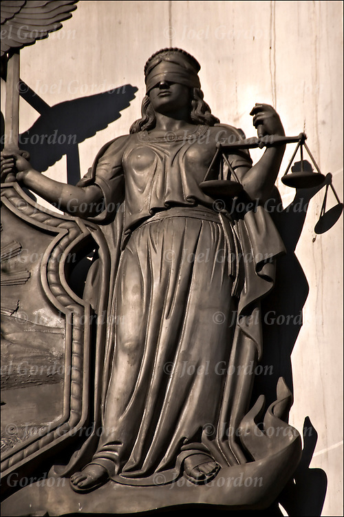 Blind justice (concept) is a legal concept regarding the neutrality of the dispensing of justice. Blind Justice is the theory that law should be viewed objectively. That means that determination of innocence or guilt should be made without bias or prejudice.  Statue of Lady Justice on side of building in lower manhattan.