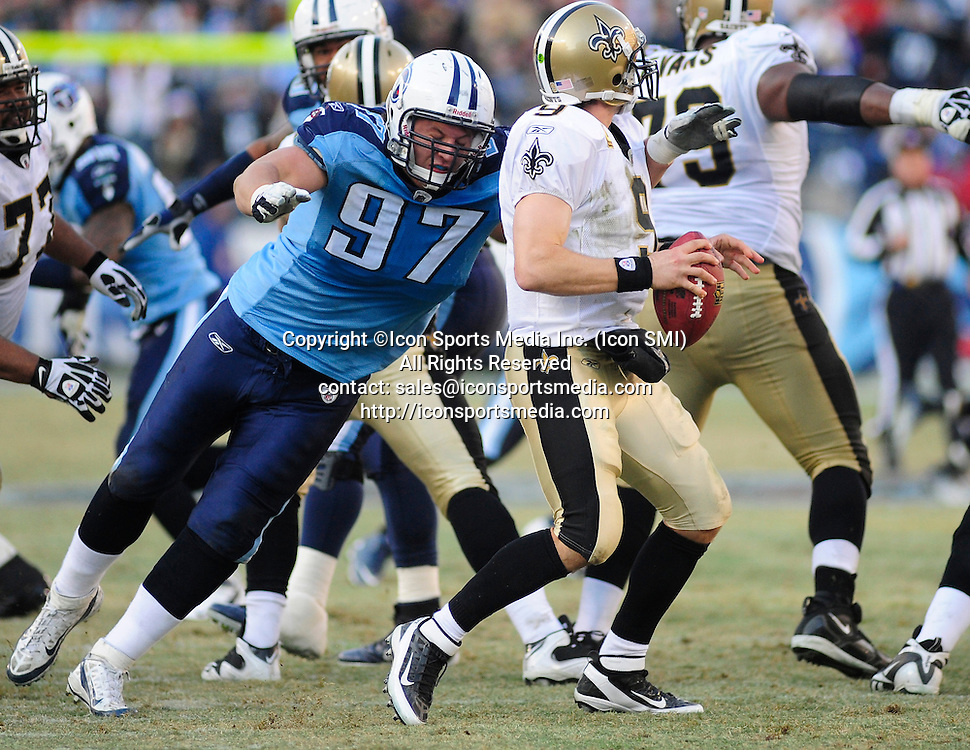 Dec. 11, 2011 - Nashville, Tennessee, United States of America - Tennessee Titans defensive tackle Karl Klug (97) sacks New Orleans Saints quarterback Drew Brees (9) in NFL action at LP Field in Nashville. The Saints beat the Titans 22-17