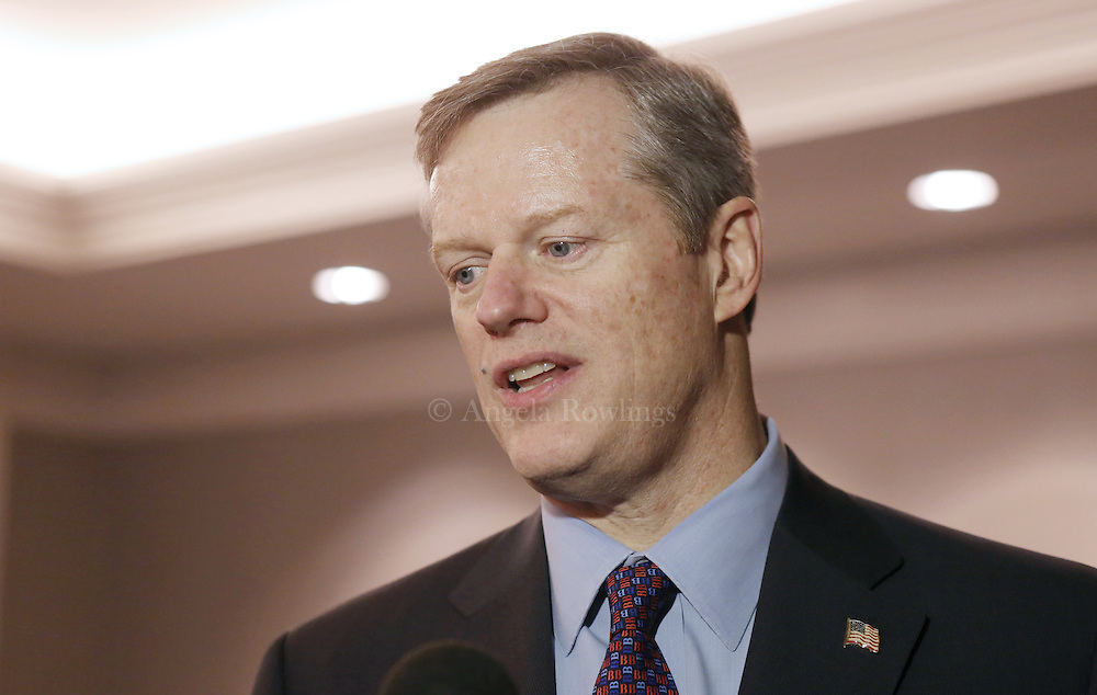 (Boston, MA - 3/11/15) Gov. Charlie Baker speaks with reporters about the MBTA and Hillary Clinton's email records, Wednesday, March 11, 2015. Staff photo by Angela Rowlings.